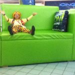 Raynbow the Clown on the couch in Davenport