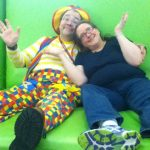 Raynbow and Goofy Grape on the big couch