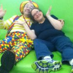 Raynbow and Goofy Grape on the giant couch in Davenport