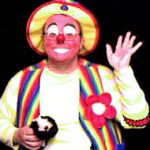 Raynbow the clown and his spring puppet friend, Mr. Kitty