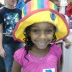 A young lady models Raynbow's hat