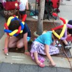 Kids with hats doing chalk art