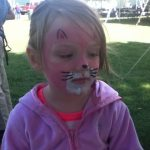 Young girl with a painted cat's face