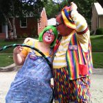 Raynbow and Goofy Grape before the parade