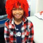 Cedric wearing my clown wig