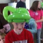 Young man with a frog hat