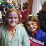 A pair of cat faces - the young ladies at Alma Center did the face on the left, Trudy did the face on the right