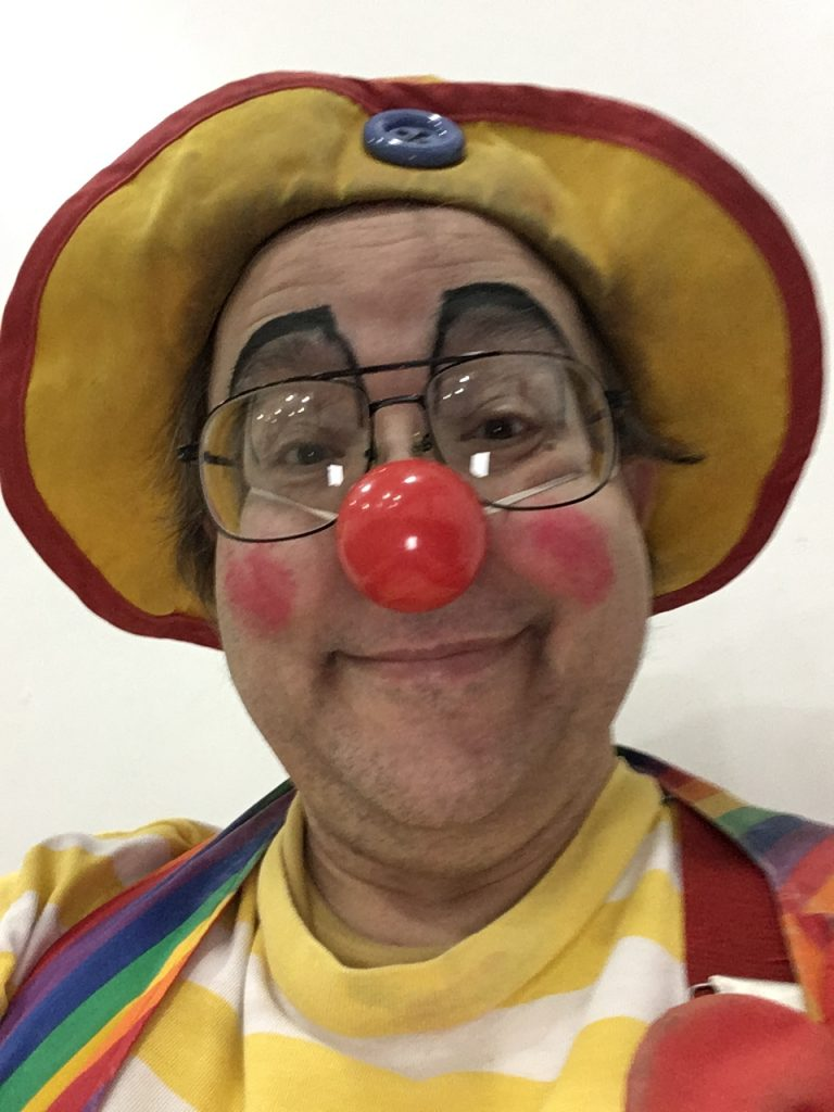 Minimal clown makeup at the New Glarus Bible Church's Grand Prix