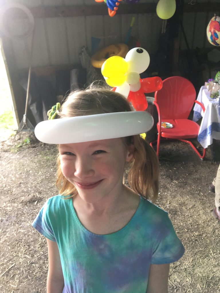 Young lady wanted a chicken hat