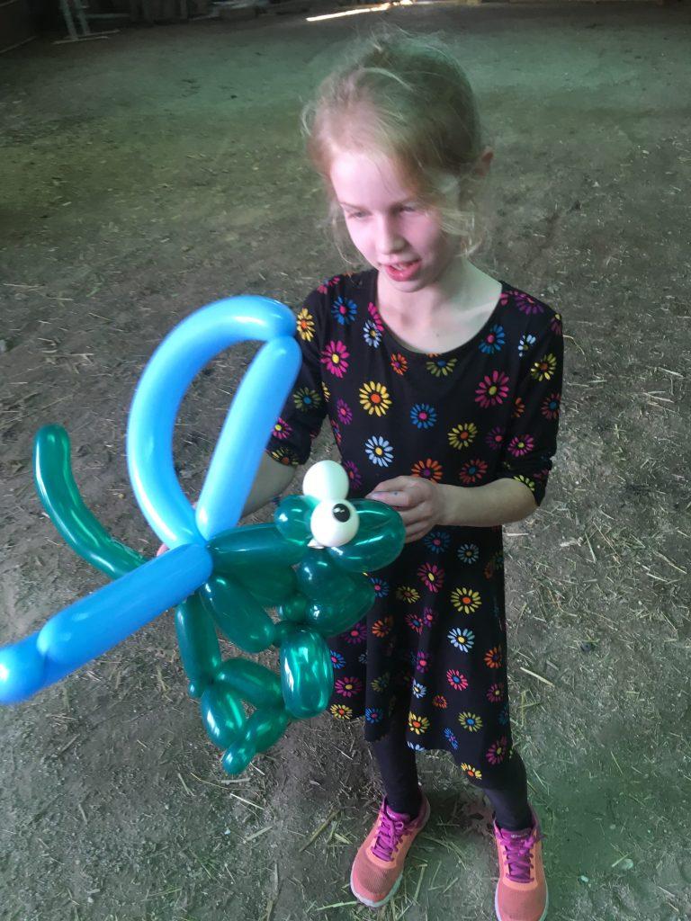 Birthday girl Maddie with a dragon