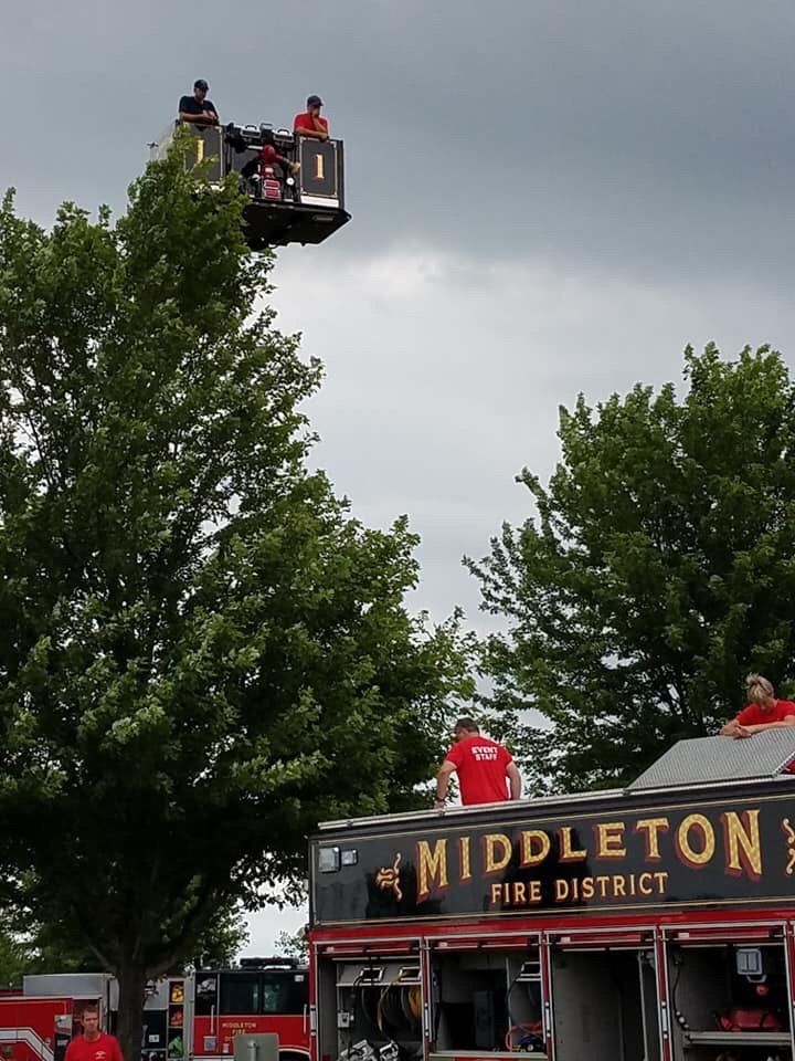 Fire department giving rides on the lift - notice those dark clouds in the background