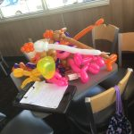 Pile of balloons that kids left on the table while they went to the bounce house. Yes, my hands are sore ...