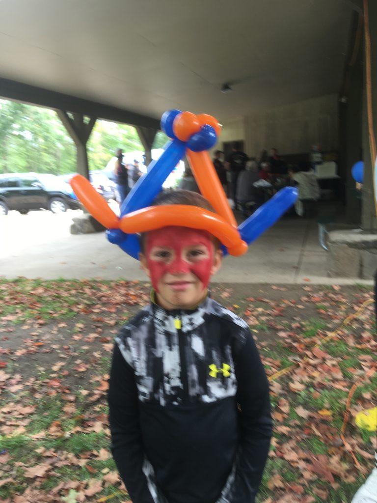 Flashy superhero with a balloon hat